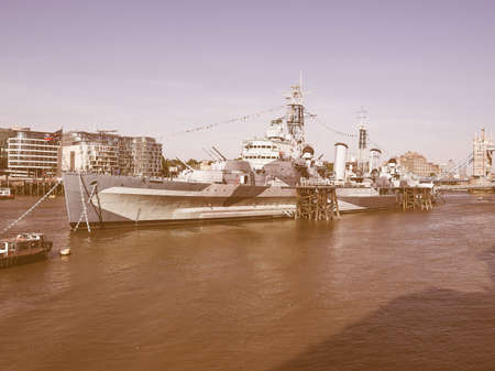 permanently: LONDON, UK - JUNE 11, 2015: HMS Belfast ship originally a Royal Navy light cruiser is now permanently moored on the River Thames as a museum ship vintage Editorial