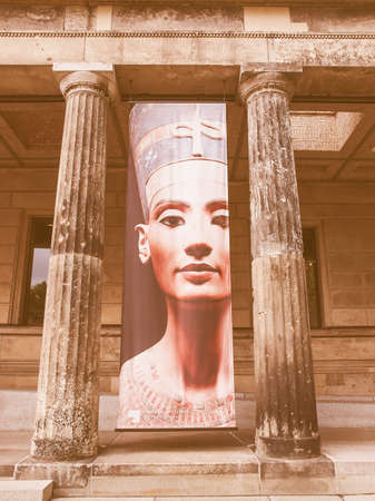 queen nefertiti: BERLIN, GERMANY - MAY 10, 2014: Banner with Egyptian queen and Sun Goddess Nefertiti in front of the Neues Museum which hosts her bust vintage Editorial