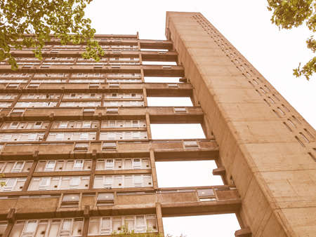 hamlets: LONDON, ENGLAND, UK - MAY 06, 2010: The Balfron Tower designed by Erno Goldfinger in 1963 is a Grade II listed masterpiece of new brutalist architecture vintage