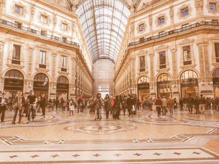 recently: MILAN, ITALY - MARCH 28, 2015: Tourists visiting the Galleria Vittorio Emanuele II recently restored for the Expo Milano 2015 international exhibition vintage Editorial