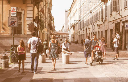 during: TURIN, ITALY - AUGUST 05, 2015: Tourists visiting the city during the summer holidays vintage