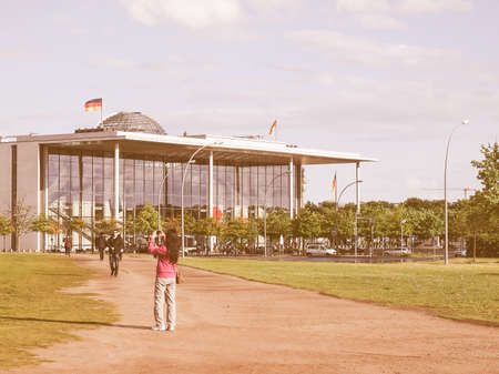bundes: BERLIN, GERMANY - MAY 11, 2014: People visiting the Band des Bundes complex of government buildings near the Reichstag (German parliament) build in 1995 following the reunification of Germany vintage Editorial