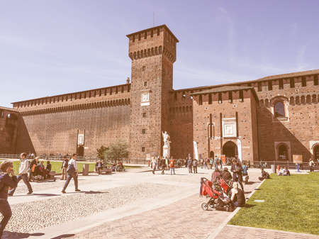 sforza: MILAN, ITALY - MARCH 28, 2015: People visiting the Sforza Castle aka Castello Sforzesco which is the oldest castle in town vintage Editorial