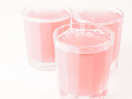 grapefruit juice: Pink grapefruit juice glasses on continental breakfast table vintage Stock Photo