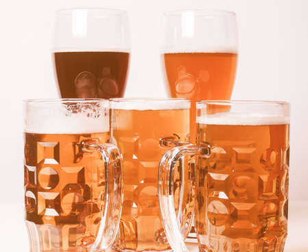 bier: Many glasses of German beers including weiss dunkel and lager vintage Stock Photo