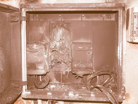 caused: Distribution board breaker panel of an electricity supply system damaged by surge caused by lightning vintage Stock Photo