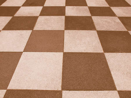 tile cladding: Vintage looking A checkered floor useful as a background Stock Photo