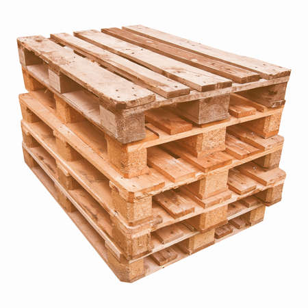 on the skids: Pile of wooden pallets or skids - isolated over white background vintage
