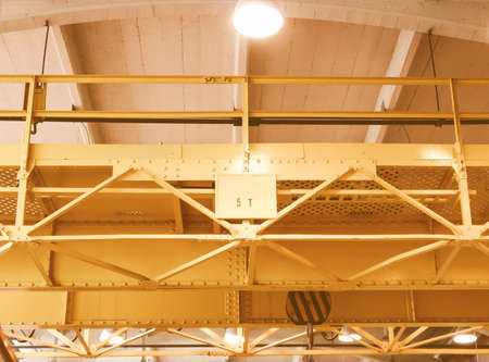 overhead crane: Detail of an industrial overhead crane for heavy weights lifting vintage Stock Photo