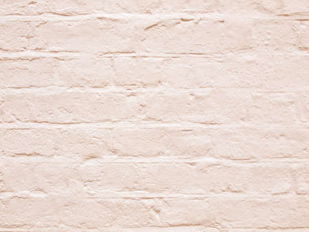 Vintage looking White brick wall useful as a background Stock Photo