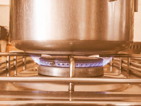 gas cooker: Detail of a saucepot on a gas cooker vintage