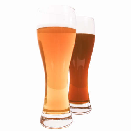 weizen: Two glasses of German dark and white weizen beer isolated over white vintage Stock Photo