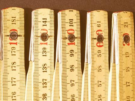 metric: Detail of a wooden metric carpenter ruler vintage
