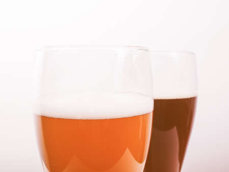 bier: Two glasses of German dark and white weizen beer vintage