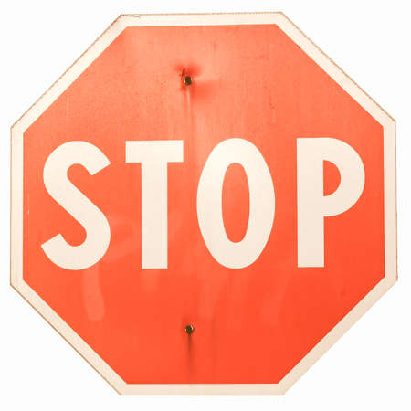 alt: Stop traffic sign isolated on white background vintage