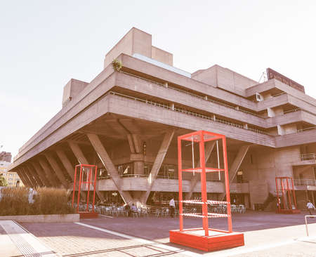 sir: LONDON, UK - SEPTEMBER 28, 2015: The National Theatre designed by Sir Denys Lasdun is a masterpiece of new brutalist architecture vintage