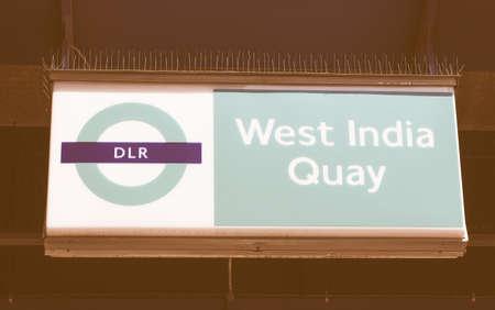 docklands: LONDON, UK - JUNE 11, 2015: Docklands Light Railway sign at West India Quay vintage