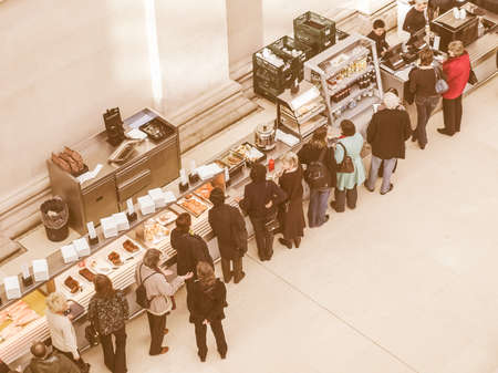 british people: LONDON, UK - CIRCA MARCH, 2009: People queueing at the British Museum cafeteria bar in the Great Court vintage