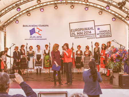 BERLIN, GERMANY - MAY 09, 2014: Bulgarian Voices Choir at the Europafest at Brandenburg Gate for the forthcoming European elections (Europawahl) moderated by Marion Pinkpank from Radio Berlin vintage