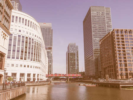 largest: LONDON, UK - JUNE 11, 2015: The Canary Wharf business centre is the largest business district in the United Kingdom vintage Editorial