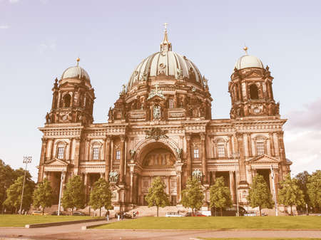 and germany: BERLIN, GERMANY - MAY 11, 2014: Tourists visiting the Berliner Dom cathedral church in Berlin Germany vintage