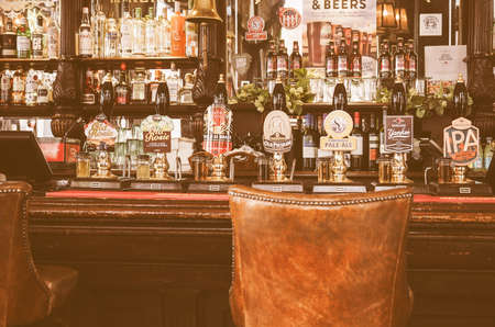 draught: LONDON, UK - SEPTEMBER 28, 2015: Draught cask beers in a traditional English Pub vintage Editorial