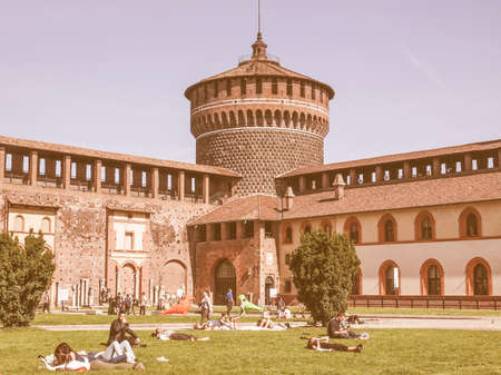 sforzesco: MILAN, ITALY - APRIL 10, 2014: People visiting the Sforza Castle aka Castello Sforzesco which is the oldest castle in town vintage