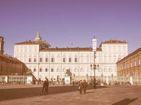 castello: TURIN, ITALY - OCTOBER 22, 2014: Tourists visiting Piazza Castello, the central baroque square vintage Editorial
