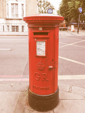 royal mail: LONDON, UK - SEPTEMBER 27, 2015: Royal Mail mailbox for mail collection vintage