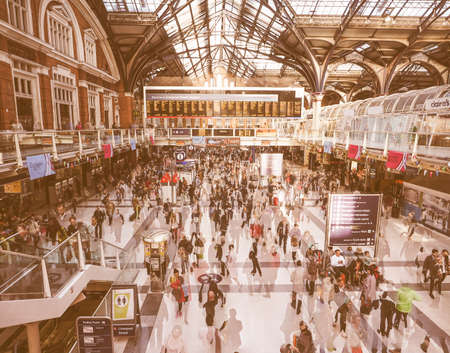 lapse: LONDON, UK - SEPTEMBER 28, 2015: Travellers at Liverpool Street Station multi exposure time lapse vintage