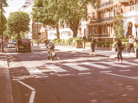 the beatles: LONDON, UK - JUNE 10, 2015: Abbey Road zebra crossing made famous by the 1969 Beatles album cover vintage Editorial
