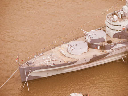 permanently: LONDON, UK - JUNE 10, 2015: HMS Belfast ship originally a Royal Navy light cruiser is now permanently moored on the River Thames as a museum ship vintage Editorial