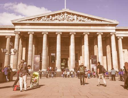 british museum: LONDON, UK - SEPTEMBER 28, 2015: Tourists visiting the British Museum vintage