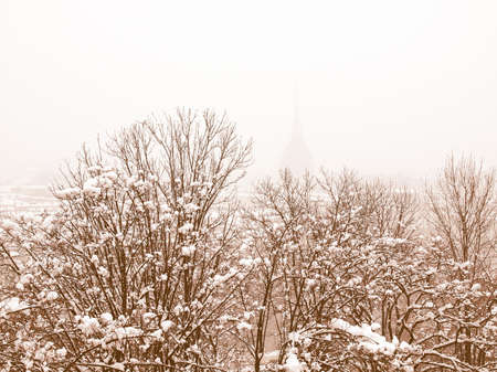 birdeye: City of Turin (Torino) skyline panorama seen from the hill - winter view with snow vintage