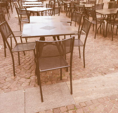 alfresco: Tables and chairs of a dehors alfresco bar restaurant pub vintage Stock Photo