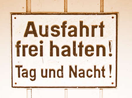 frei: A sign meaning to leave the exit free all time day and night, in German vintage