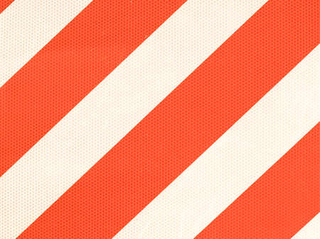 reflective: Reflective red and white stripes on a traffic sign vintage