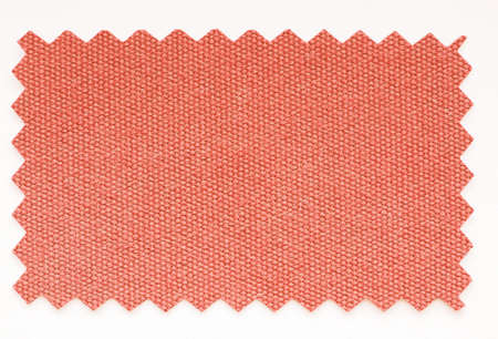 zig zag: Red fabric swatch cut with pinking shears zig zag scissors vintage Stock Photo