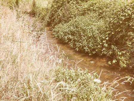 rivulet: Vintage looking Water rivulet for fields and meadows irrigation Stock Photo