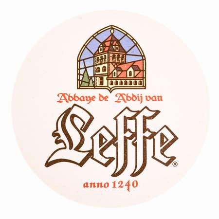 belgie: BRUSSELS, BELGIUM - MARCH 15, 2015: Beermat of Belgian beer Leffe isolated over white background vintage Editorial
