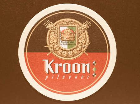 belgie: BRUSSELS, BELGIUM - DECEMBER 11, 2014: Beermat of Belgian beer Kroon pilsner vintage