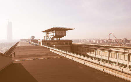 fiat: TURIN, ITALY - DECEMBER 16, 2015: Roof top race track at Lingotto former Fiat car factory vintage