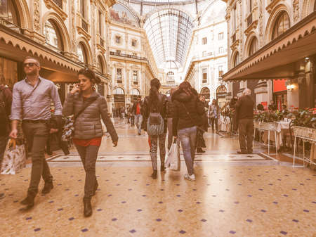 restored: MILAN, ITALY - MARCH 28, 2015: People visiting the newly restored Galleria Vittorio Emanuele II vintage Editorial
