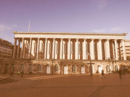 venue: BIRMINGHAM, UK - SEPTEMBER 25, 2015: Tourists in front of Town Hall concert venue vintage