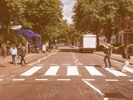 album cover: LONDON, ENGLAND, UK - JUNE 18: Abbey Road zebra crossing made famous by the 1969 Beatles album cover on June 18, 2011 in London, England, UK vintage