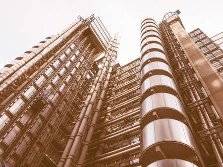richard: LONDON, UK - SEPTEMBER 29, 2015: Lloyd of London is an iconic high tech skyscraper designed by architect Richard Rogers vintage