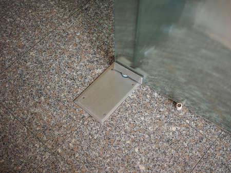 hinge: Detail of an indoor glass door hinge