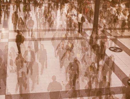 LONDON, UK - SEPTEMBER 28, 2015: Travellers at Liverpool Street Station multi exposure time lapse vintage Redakční