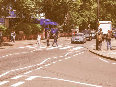 18 month old: LONDON, ENGLAND, UK - JUNE 18: People crossing the Abbey Road zebra crossing made famous by the 1969 Beatles album cover on June 18, 2011 in London, England, UK vintage
