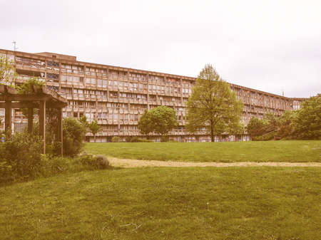 sixties: LONDON, ENGLAND, UK - MARCH 05, 2009: The Robin Hood Gardens housing estate designed in late sixties by Alison and Peter Smithson is a masterpiece of new brutalist architecture vintage